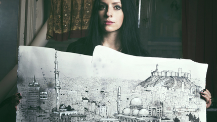"Molly Crabapple holds one of her drawings from her book ""Brothers of the Gun: A Memoir of the Syrian War."""