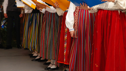 A row of multi-colored woolen skirts