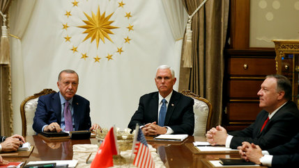 US Vice President Mike Pence and Secretary of State Mike Pompeo sit around a table with Turkish President Tayyip Erdogan