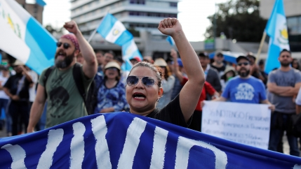 A female protester raises her fist as she takes part in a march to protest against the decision of Guatemala President Jimmy Morales to end the mandate of the UN-backed anti-graft commission, the CICIG, in Guatemala City, Guatemala, January 12, 2019.