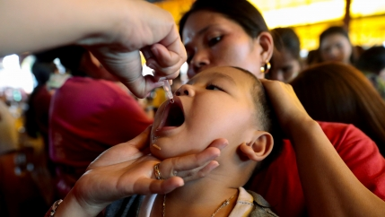 A child receives free polio vaccine during a government-led mass vaccination program in Quezon City, Metro Manila, Philippines, October 14, 2019.