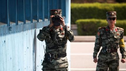 ANorthKorean soldier keeps watch toward the south through a binocular telescope