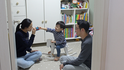 Seo Ji-hye and Cho Sung-won watch as their two-year-old son, Han-sol, plays with a toy train in his bedroom in Seoul.