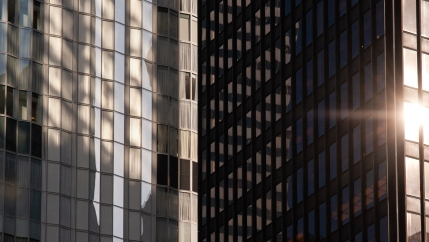 The sun reflects off the Seagrams Building (foreground) in Midtown Manhattan.