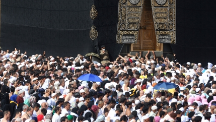 A police officer wears a face mask to prevent contracting coronavirus, as Muslim pilgrims pray at Kaaba in the Grand mosque in the holy city of Mecca, Saudi Arabia, on Feb. 27, 2020.