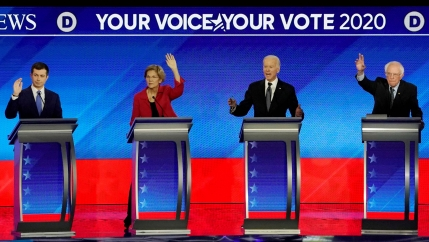 Democratic 2020 US presidential candidates (left to right) former South Bend Mayor Pete Buttigieg, Senator Elizabeth Warren, former Vice President Joe Biden and Senator Bernie Sanders participate in the eighth Democratic 2020 presidential debate.