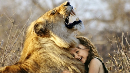 Child hugging lion, roar
