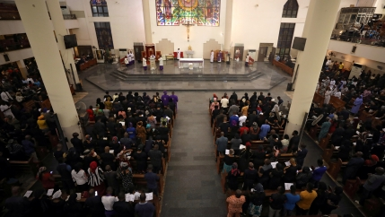 People attend Ash Wednesday mass in a church in Abuja, Nigeria, Feb. 26, 2020.