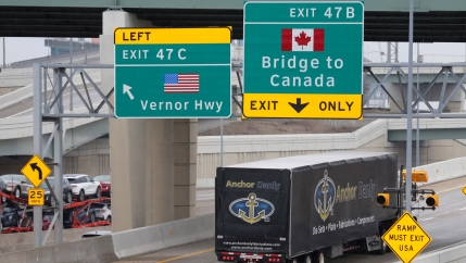 A commercial truck heads for the Ambassador Bridge, during the coronavirus disease (COVID-19) outbreak, at the international border crossing, which connects with Windsor, Ontario, in Detroit, Michigan, on March 18, 2020.