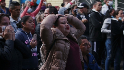 Relatives of prisoners react outside La Modelo prison after a riot by prisoners demanding government health measures against the spread of the coronavirus disease (COVID-19) in Bogota, Colombia, on March 22, 2020.