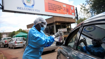 A health worker screens and sanitises visitors to prevent the spread of coronavirus disease (COVID-19) outside a hospital in Harare, Zimbabwe March 26, 2020.