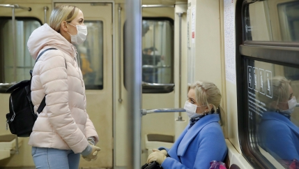 Women wearing protective masks travel in a metro train during a partial lockdown imposed to prevent the spread of coronavirus disease (COVID-19) in Moscow, Russia, on April 2, 2020.