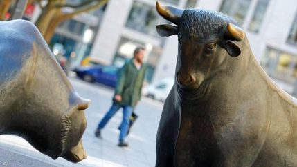 Bull and bear, symbols for successful and bad trading are seen in front of the German stock exchange