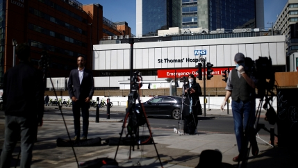 Several television cameras are shown set up with reporters standing in front and St Thomas' Hospital in the background.