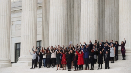 DACA plaintiffs walk arm-in-arm down from the US Supreme Court after justices heard oral arguments in the consolidation of three cases before the court regarding the Trump administration's bid to end the DACA program on Nov. 12, 2019.