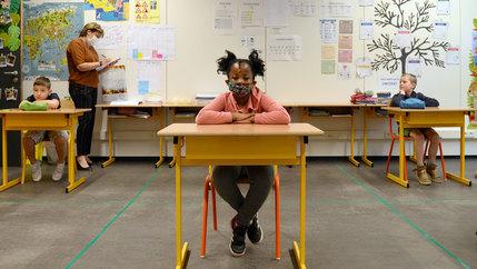 A child at a desk