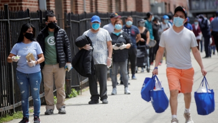 People wait in line at a food bank at St. Bartholomew Church, during the outbreak of the coronavirus disease (COVID-19) in the Elmhurst section of Queens, New York City, New York, May 15, 2020.
