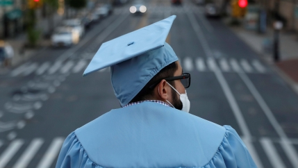 A graduating Masters student from the Columbia University stands on campus the day before his graduation ceremony, which is to be held online due to the outbreak of the coronavirus disease in New York City, on May 19, 2020.