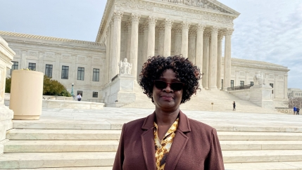 Doreen Oport, who was injured in the attack on the US Embassy in Nairobi, Kenya in 1998, stands outside the US Supreme Court after oral arguments in Washington, Feb. 24, 2020.