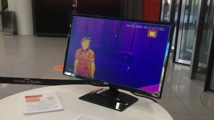 The World's Orla Barry is seen stepping through a thermal scanner at the BBC.