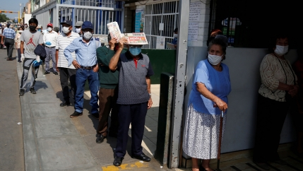 People wait outside Lima's central market as Peru extended a nationwide lockdown amid the outbreak of the coronavirus disease (COVID-19), May 8, 2020.