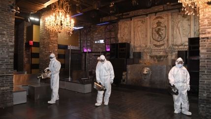 Quarantine worker spray disinfectants at a night club on the night spots in the Itaewon neighborhood, following the coronavirus disease (COVID-19) outbreak, inSeoul, South Korea, May 12, 2020.