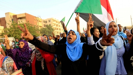 Sudanese protesters march during a demonstration to commemorate 40 days since the sit-in massacre in Khartoum North, Sudan, on July 13, 2019.