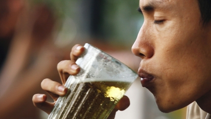 A man drinks beer at a restaurant in Hanoi, July 20, 2009. In smaller markets in Southeast Asia such as Singapore, Thailand and Vietnam, drinking beer is becoming a popular pastime due to rising disposable income and relatively young populations who are e