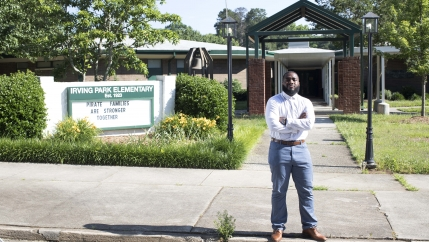 Brayan Guevara in front of Irving Park Elementary School, in Greensboro, North Carolina, where he is a teacher's assistant, June 3, 2020.
