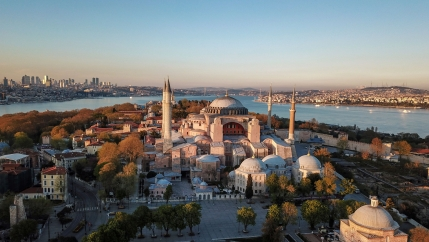 The large dome of the UNESCO World Heritage site Hagia Sophia is shown from above at a distance.