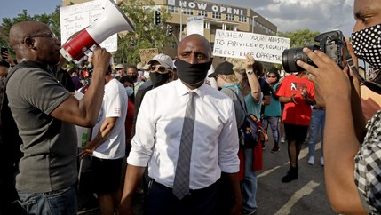 Kansas City mayor Quinton Lucas, center, walks among protesters Wednesday, June 3, 2020, in Kansas City, Mo., during a unity march to protest against police brutality following the death of George Floyd.