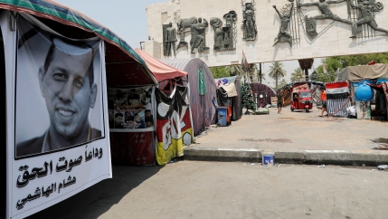 A poster depicting the former government adviser and political analyst Husham al-Hashimi, who was killed by gunmen, is seen in Tahrir Square in Baghdad, July 8, 2020.