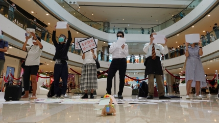 Pro-democracy demonstrators take part in a lunchtime protest against the national security law, at a shopping mall in Hong Kong, July 6, 2020.