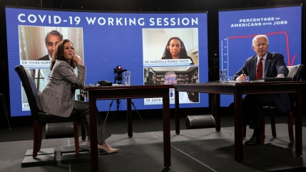 Democratic presidential candidate Joe Biden and vice presidential candidate Kamala Harris are seated prior to participating in a briefing on the pandemic from public health officials during a campaign stop in Wilmington, Del.