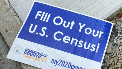 A blue and white census sign.