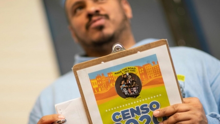 Douglas Carrasquell of the organization Make the Road New York holds documents as he attends a training meeting about National Census in Queens on March 13, 2020 in New York City