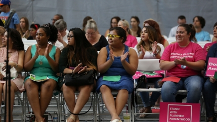 People attend a bilingual health care town hall sponsored by local organizations that work in Latino voter outreach, disability advocacy and community health at the Ability360 Center in Phoenix, July 5, 2017. Senators John McCain and Jeff Flake were invit