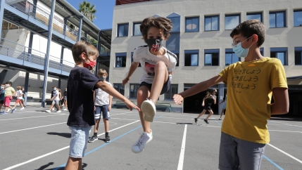 Secondary school students play in the courtyard at the College Henri Matisse school during its reopening in Nice as French children return to their schools after the summer break.