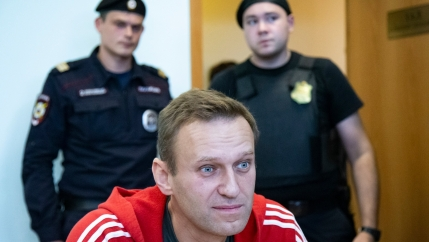 Russian opposition leader Alexei Navalny speaks to the media prior to a court session in Moscow, Russia.