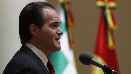 A man in a suit speaks in public