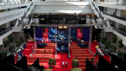 The stage is shown being setup for the first 2020 president debate with red carpet and scafolding for various lighting.