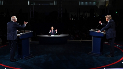 President Donald Trump and Democratic presidential candidate former Vice President Joe Biden are shown on either side of the photo, each standing at a podium and facing a moderator.