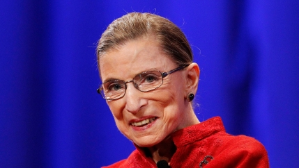 the late Supreme Court Justice Ruth Bader Ginsburg wears a bright red suit jacket