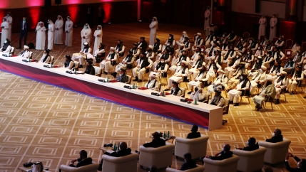 Delegates attend talks between the Afghan government and Taliban insurgents in Doha, Qatar, Sept. 12, 2020.