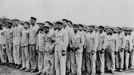 Black and white photo of prisoners at Buchenwald.