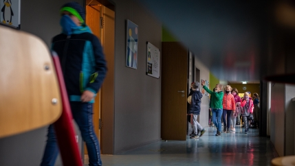 Students return to class after recess at Weimar Schöndorf primary school in Germany.