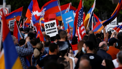 People take part in a protest by Armenian Youth Federation against what they refer to as Azerbaijan's aggression against Armenia and the breakaway Nagorno-Karabakh region, outside the Azerbaijani Consulate General in Los Angeles, Calif., Sept. 30, 2020.