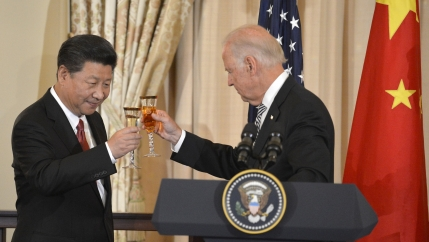 Chinese President Xi Jinping and then-Vice President Joe Biden raise their glasses in a toast during a luncheon at the State Department, in Washington, Sept. 25, 2015.