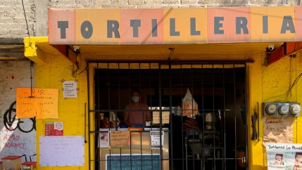 Fernando Lozano, co-owner of La Abuela tortilla shop in southern Mexico City, stands inside his bakery.