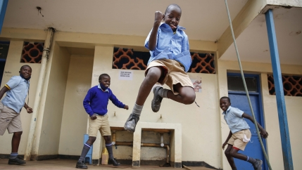 Schoolchildren joke around and play at the Olympic Primary School in Kibera, Kenya, on Oct. 12, 2020.